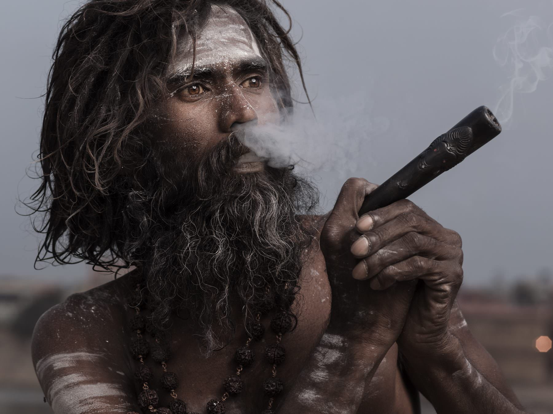 India, Varanasi, Sadhu is smoking morning Ganja