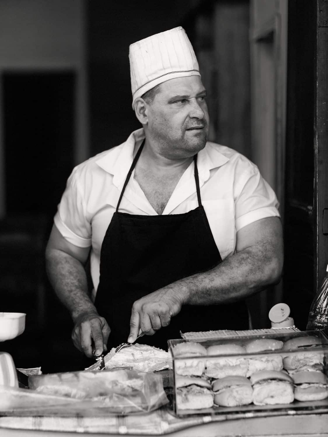 The sandwich man is very busy during lunch time and he is just gazing a young girl who passed by….