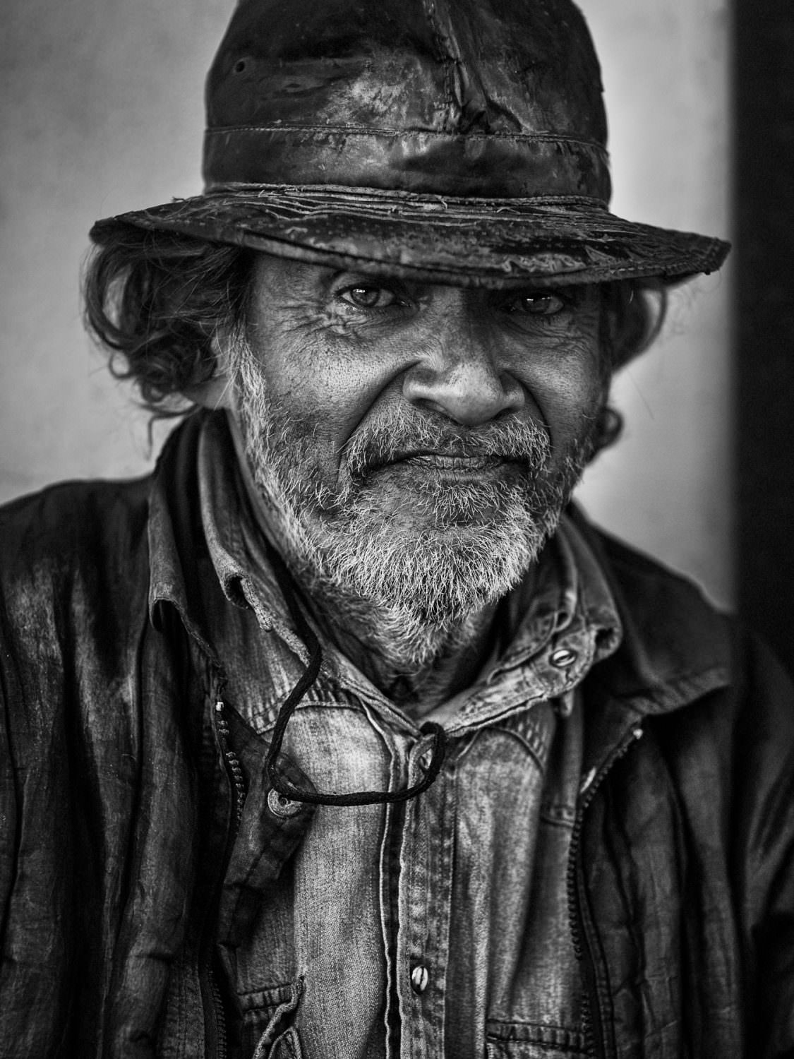 Cuba Havana - Old man sits on a bench and is watching the evening travic at the monte street Copyright © by Gerry Pacher