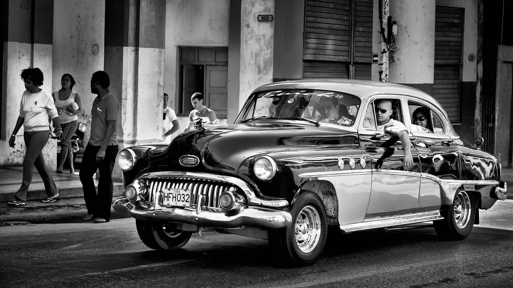 Cuba Havana Monte Street - a taxi drives up the monte street © by Gerry Pacher