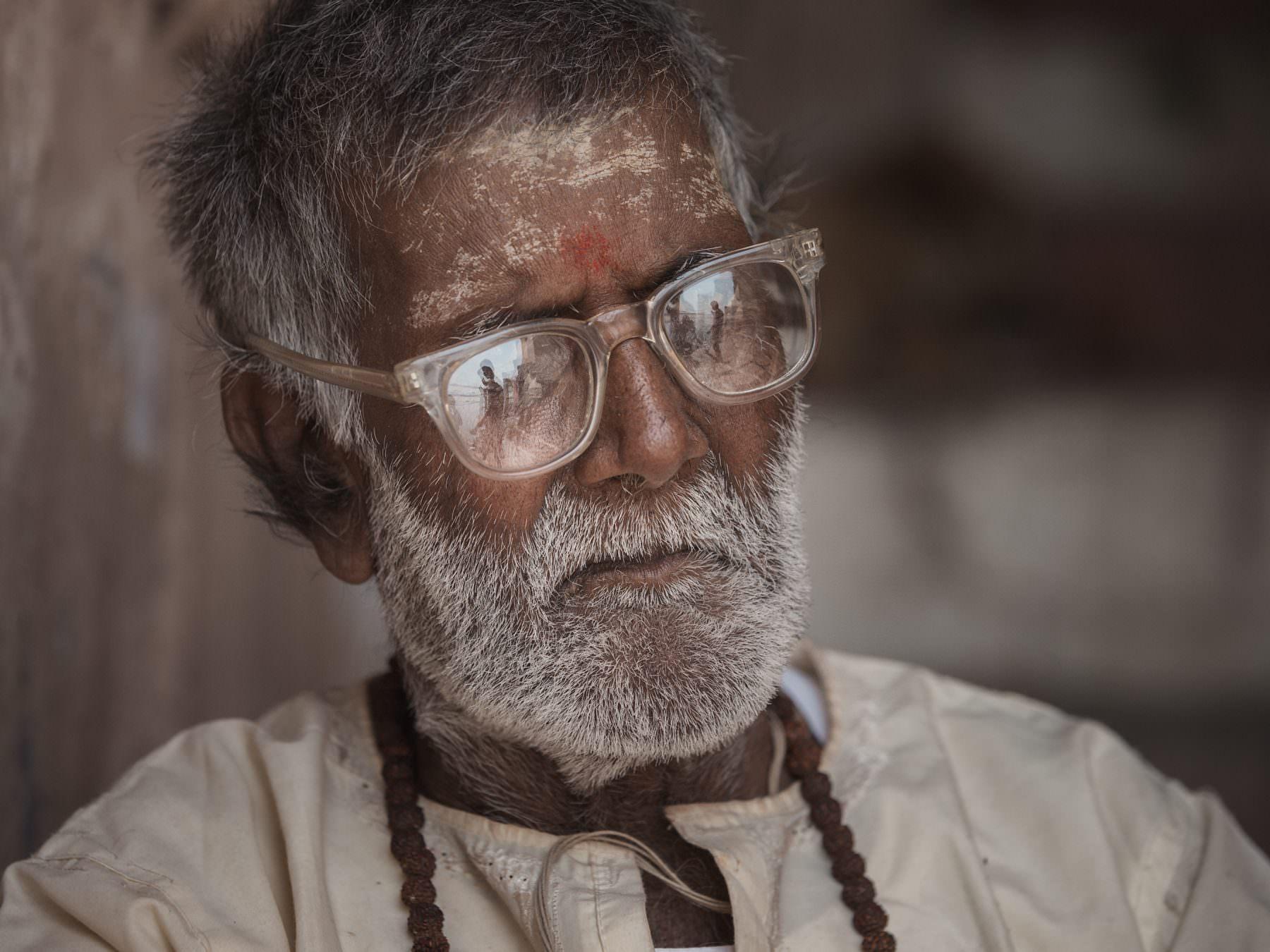 Faces of Varanasi: Old Brahmin is watching a Kite Runner, India, Varanasi, Ganga