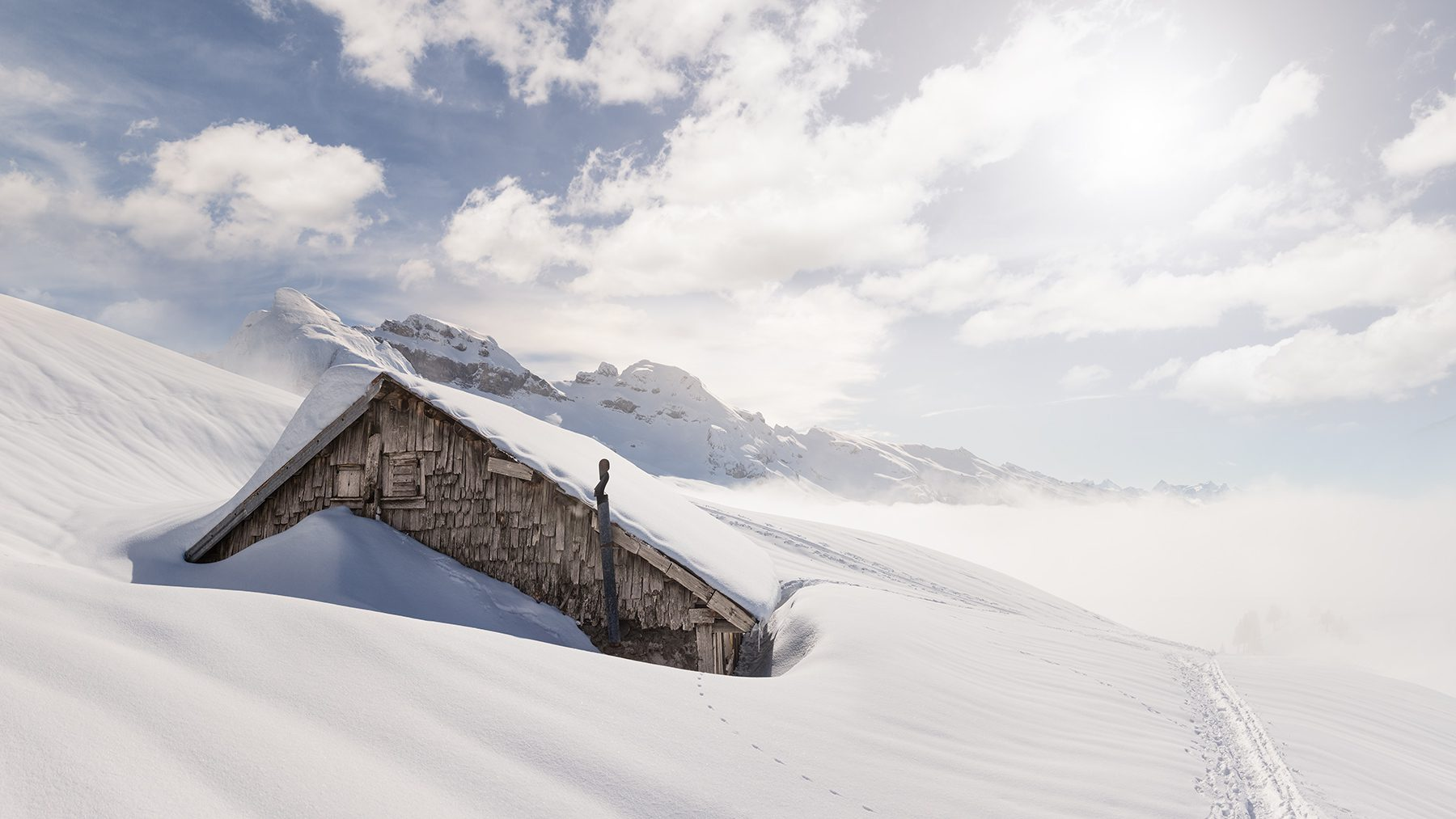 eingeschneite Alp am Fusse des Druesbergs mit Blick auf den Druesberg, Forstberg, Region Hoch-Ybrig