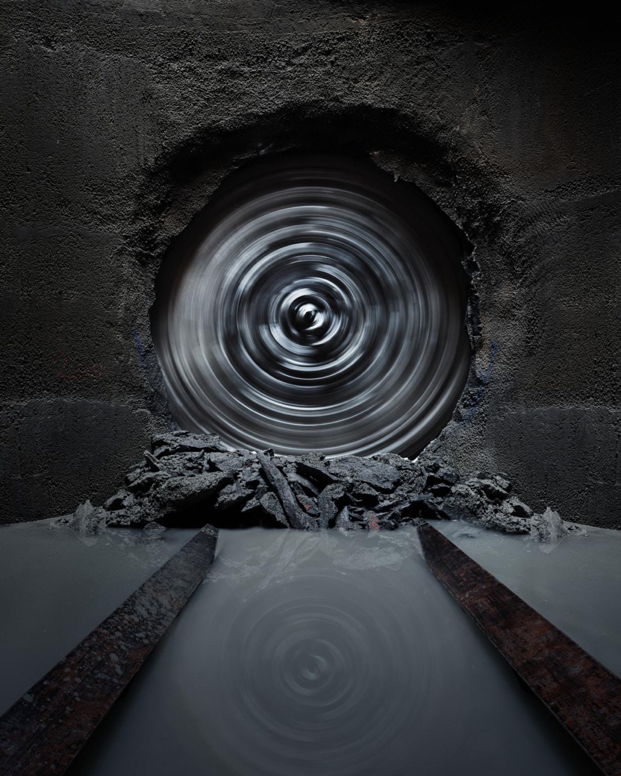 Sonntag Bau AG - Fernwärme Projekt Zürich - Microtunneling - Bohrkopf beim Durchbruch in voller Aktion